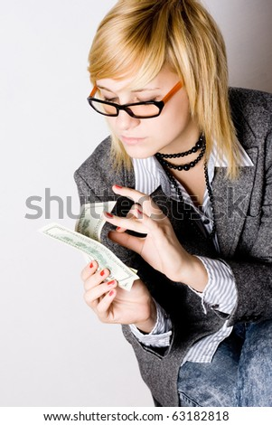 portrait of businesswoman with money isolated on white background - stock photo