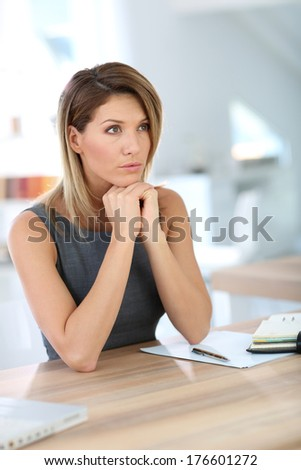 Portrait of businesswoman with serious look - stock photo