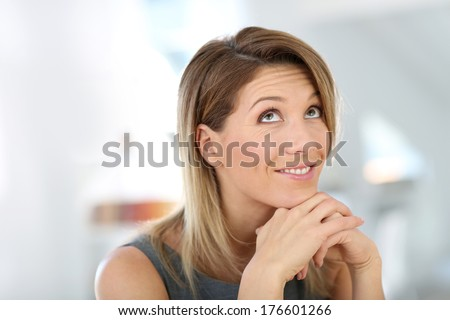 Portrait of businesswoman with smiling face - stock photo