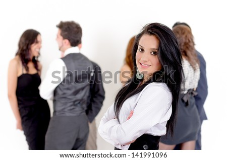 Portrait of businesswoman, with team in background - stock photo