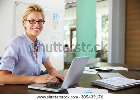 Portrait Of Businesswoman Working In Creative Office - stock photo