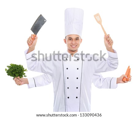 Portrait of busy chef smiling holding cooking utensil and fresh ingredient - stock photo