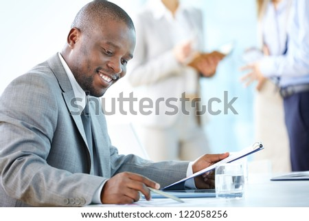Portrait of busy leader working with papers - stock photo