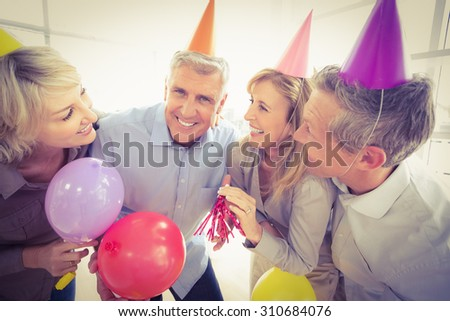 Portrait of casual business people celebrating birthday in the office - stock photo
