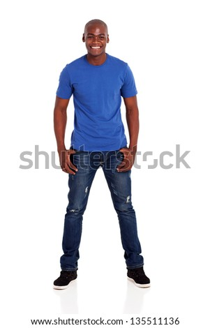 portrait of casual young african man standing on white background - stock photo