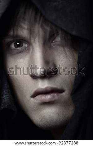 Portrait of Catholic monk in religious hood - stock photo