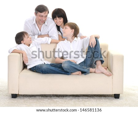 Portrait of Caucasian friendly family of four on a light background