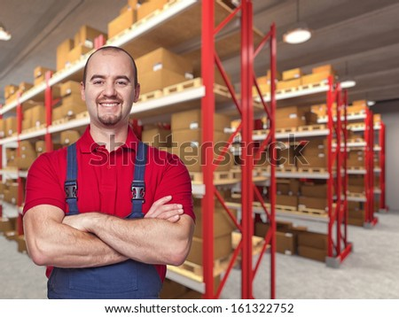portrait of caucasian handymanand warehouse background