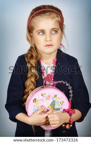 Portrait of caucasian little pretty girl looking to the left side - stock photo