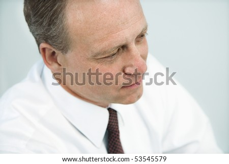 Portrait of Caucasian middle aged businessman. - stock photo