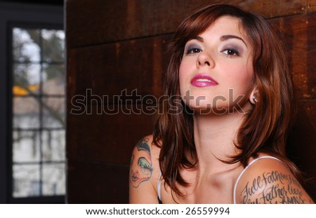 Portrait of caucasian woman dressed in lingerie inside barn - stock photo