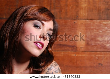 Portrait of caucasian woman dressed in lingerie inside barn