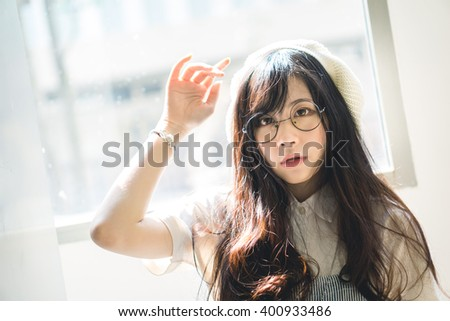 Portrait of charming Asian girl in film color style