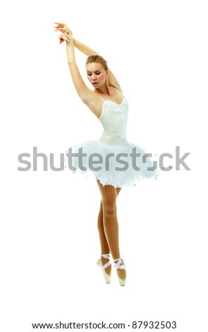 Portrait of charming ballerina dancing with raised arms on white background - stock photo