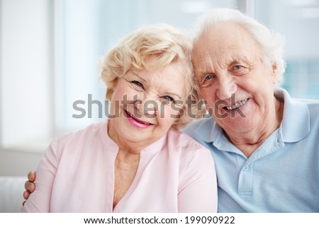 Portrait of charming seniors enjoying spending time together - stock photo