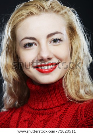 Portrait of charming smiling blonde in red sweater