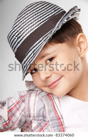 Portrait of charming stylish smiling little boy, studio shot