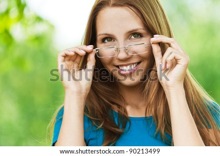 portrait of charming woman with long hair for the bow holds the glasses, smiling - stock photo