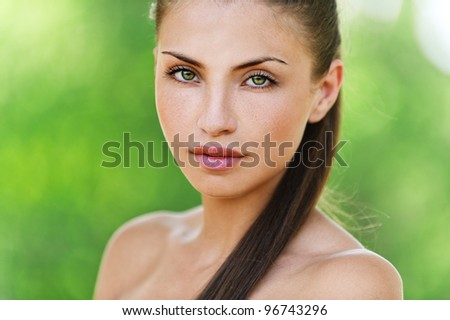 portrait of charming, young, naked woman, background summer green park - stock photo