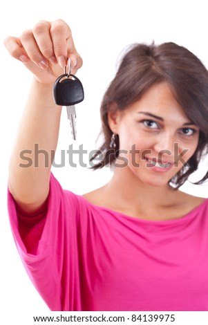 Portrait of charming young woman holding car key isolated over white background - stock photo