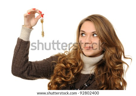 Portrait of charming young woman holding keys isolated over white background - stock photo