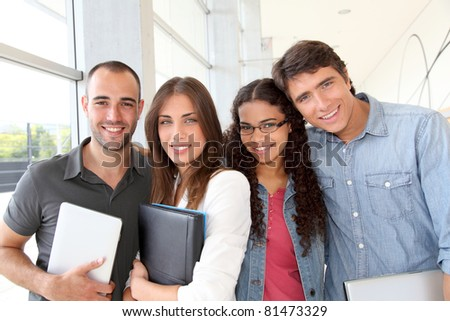 Portrait of cheeful college students - stock photo