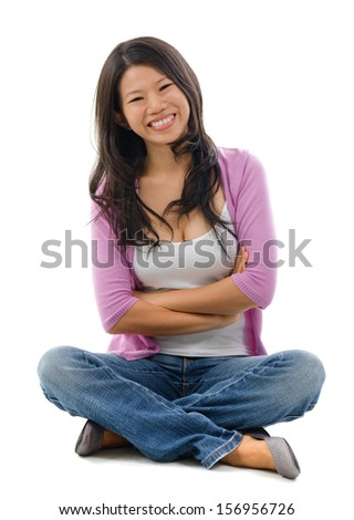 Portrait of cheerful Asian woman sitting isolated over white background. - stock photo
