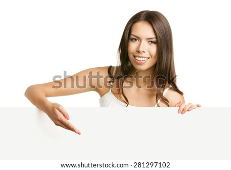 Portrait of cheerful beautiful young brunette woman in tank top casual smart clothing, showing empty blank signboard with copyspace area for text or slogan, isolated against white background - stock photo