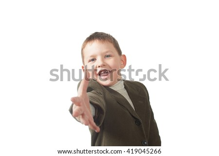 Portrait of cheerful boy with raised hands over isolated white background