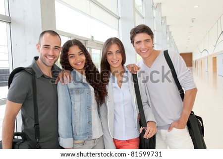Portrait of cheerful college students - stock photo