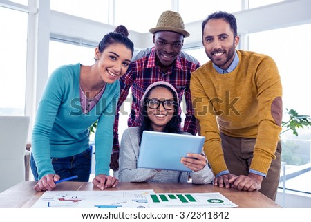 Portrait of cheerful confident business team in creative office - stock photo