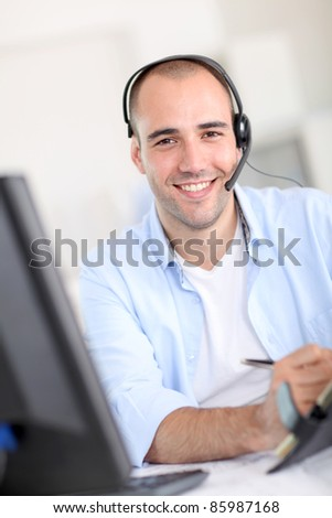 Portrait of cheerful customer service employee - stock photo