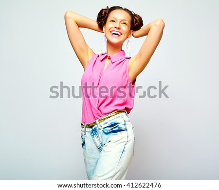 portrait of cheerful fashion hipster girl in casual colorful vivid hipster blue and pink summer clothes jeans on gray background  - stock photo