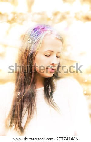 Portrait of cheerful fashionable woman in spring blooming tree, with flowers in hair, retro vintage color, shallow focus and bokeh - stock photo
