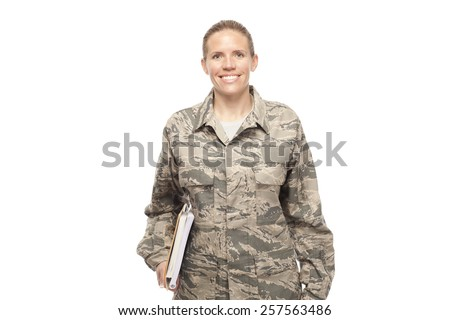 Portrait of cheerful female airman with college books against white background - stock photo