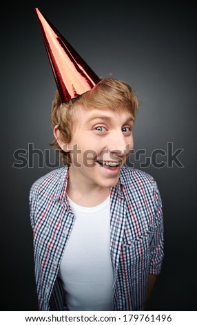 Portrait of cheerful guy at fools day celebration looking at camera with a smile - stock photo