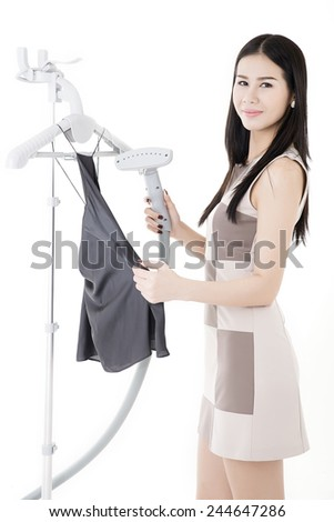 Portrait of cheerful housewife ironing clothes,Housewife ironing isolated - stock photo