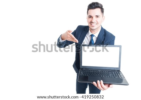 Portrait of cheerful male executive presenting a laptop with empty screen and copy space isolated on white - stock photo