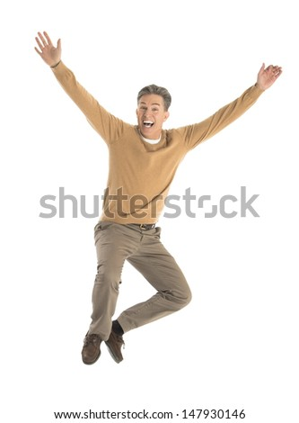 Portrait of cheerful mature man jumping over white background - stock photo