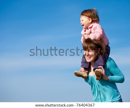 Portrait of cheerful mother and curly baby girl - stock photo