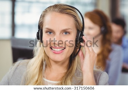 Portrait of cheerful operator with headset - stock photo