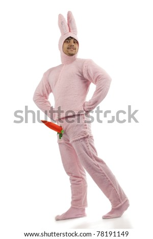 Portrait of cheerful pink rabbit is proud of his carrot isolated on white background - stock photo