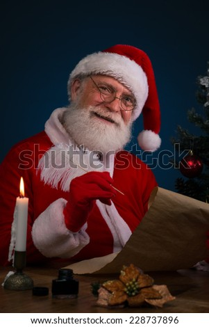 Portrait of cheerful Santa with a scroll - stock photo