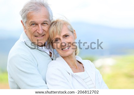Portrait of cheerful senior couple embracing each other