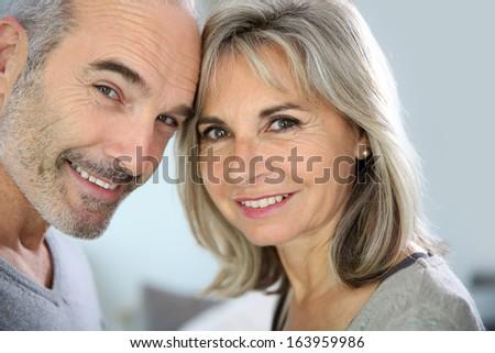 Portrait of cheerful senior couple enjoying life - stock photo