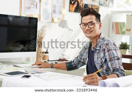 Male Interior Designers At Work asian designer stock images, royalty-free images & vectors