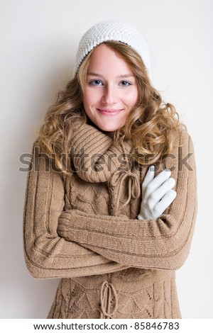 Portrait of cheerful winter fashion girl warming up for the cold season. - stock photo