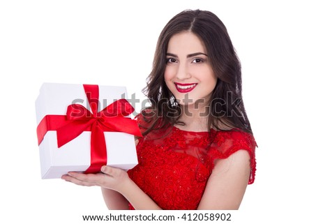 portrait of cheerful woman in red dress with gift box isolated on white background - stock photo