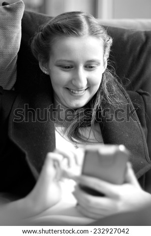 Portrait of cheerful woman using smart-phone