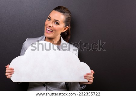 portrait of cheerful woman with paper cloud on black background - stock photo